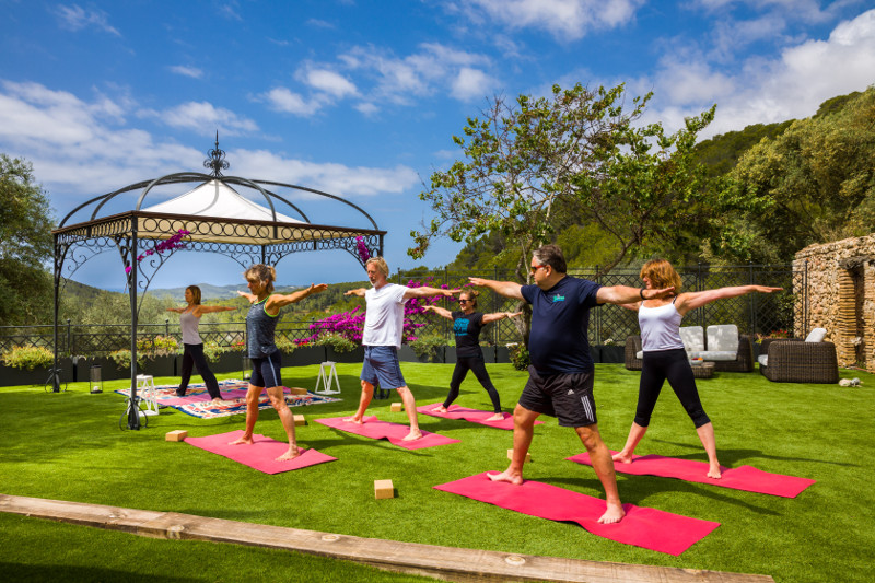 Yoga on the lawn at Can Marcer de la Penya